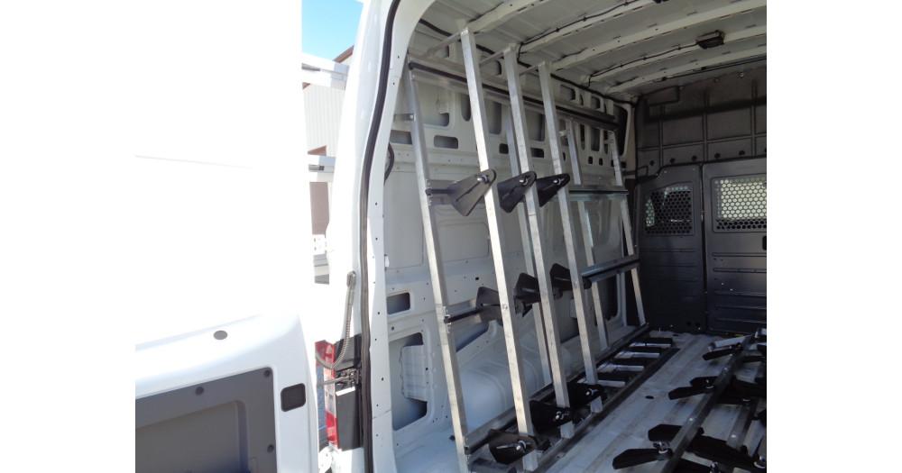 Unruh Fab Kansas Stone Transporting Nissan NV Exterior And Interior Rack 3